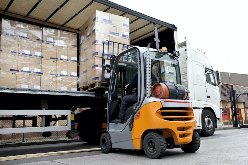 Forklift loading a Pallet into a Truck for Industrial Fulfillment order