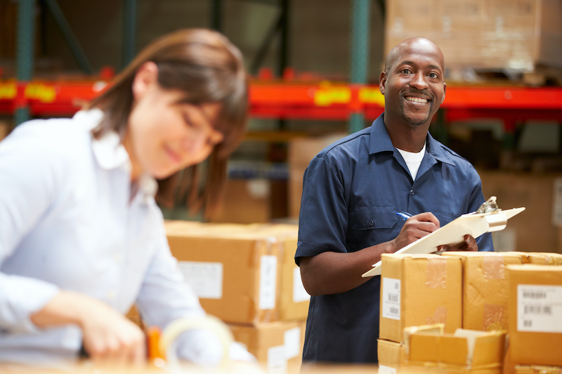 Two People Checking Inventory in Warehouse