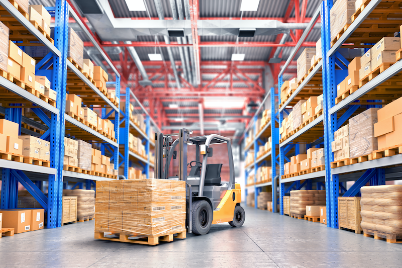 Warehouse with boxes and forklift